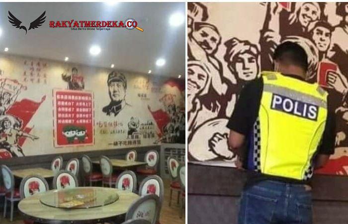 Foto Viral Polisi Malaysia Copot Stiker Komunis dari Sebuah Restoran